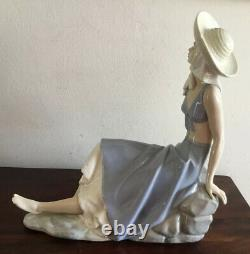Beautiful Large Lladro Nao Sitting Girl With Sun Hat On Rocks