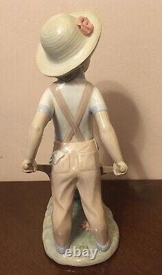 Genuine Lladro Figurine Of A Boy With A Wheelbarrow Little Gardener Model 1283