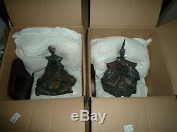 LLADRO'EMPEROR & EMPRESS' and Wood stands. 12300 &12301. 1995 to 1999