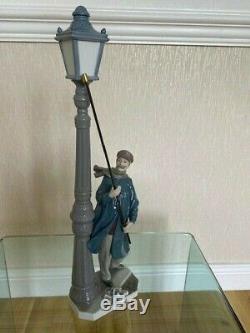 LLADRO Lamplighter Figurine. Porcelain