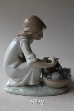 Lladro 5595 Girl with puppies in a basket'Joy in a Basket