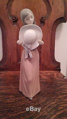 Lladro Figurine Bashful Girl with Straw Hat. 5007