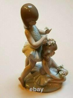 Lladro'First Ballet' No 5714. Girl ballerinas with flowers
