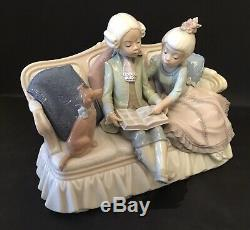 Lladro Story Time. 5229. Children reading with dog on sofa