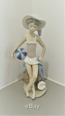 Lladro'Summer' Gloss Porcelain Figurine #5219. Designed 1984 Juan Huerta