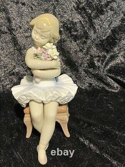 Lladro''first Performance'' Seated Ballerina With Bouquet Of Flowers