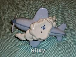 RETIRED Lladro OVER THE CLOUDS 5697 BOY AIRPLANE BIRDS SKY