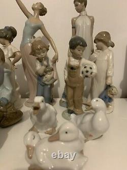 Used. Collection Of 13 nao/lladro figurines and 4 Geese Excellent Condition